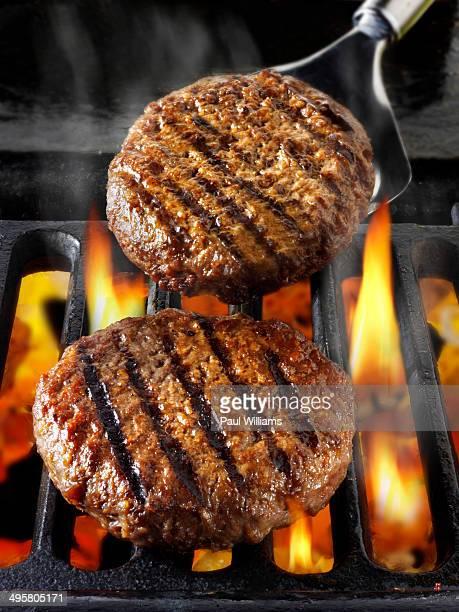 Beef burgers, hamburgers, on barbecue