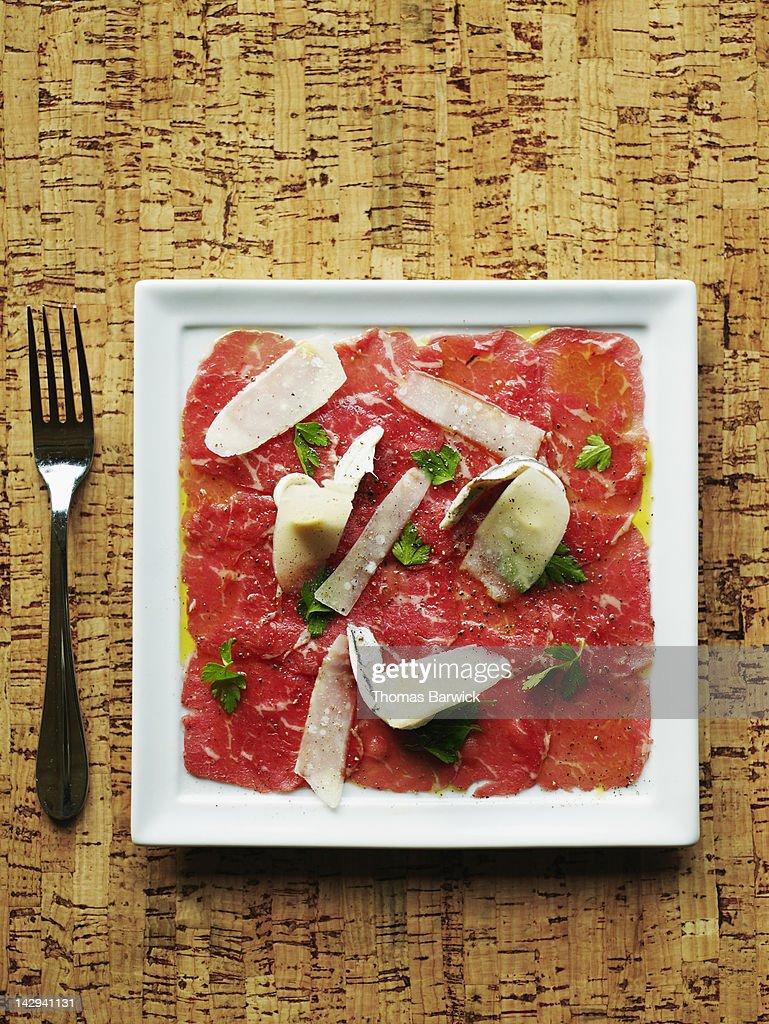 Beef carpriccio with parmesan reggiano : Stock Photo