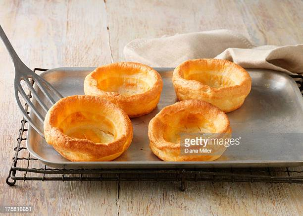 Beef dripping Yorkshire puddings on metal baking sheet