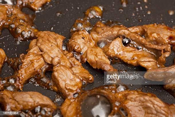 Beef in frying pan