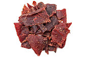 Heap of peppered Beef Jerky on white background from above