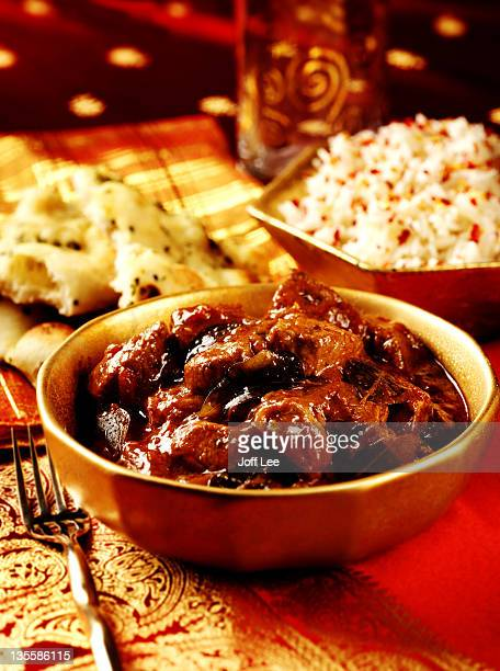 Beef madras with rice and naan bread