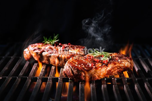 Beef steaks on the grill : Stock Photo