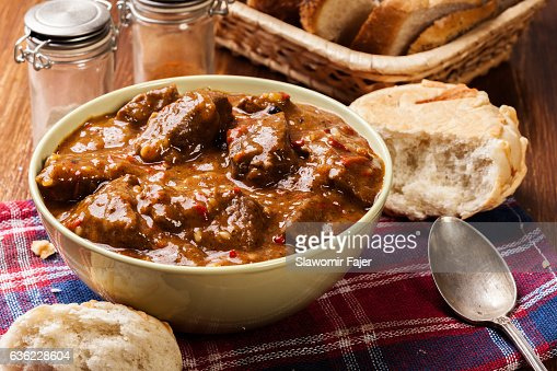 Beef stew served with crusty bread : Stock Photo