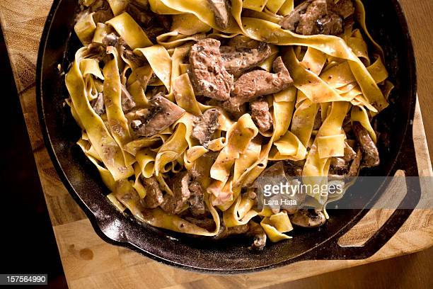 Beef stroganoff in a bowl on a wooden counter
