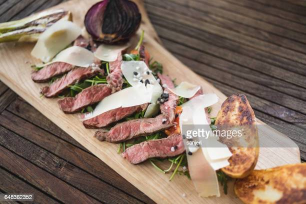 Beef Tagliata With Vegetables and Covered in Parmesan
