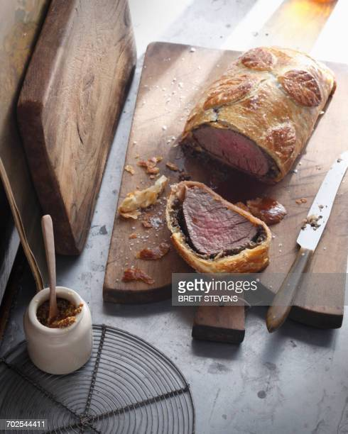 Beef wellington on cutting board