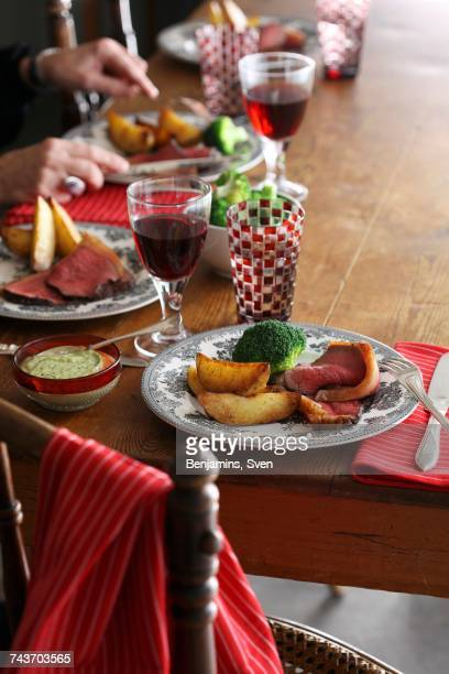 Beef with baked potatoes and broccoli