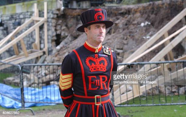 A beefeater patrols a section of the moat wall which has collapsed at The Tower of London * Structural engineers conservation specialists and English...