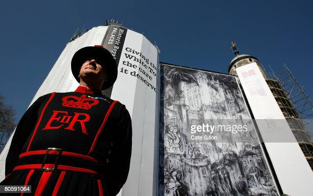 A beefeater stands guard in front of the winning entry of the drawing competition 'Hung Quartered and Drawn' which has been unveiled on the Tower of...