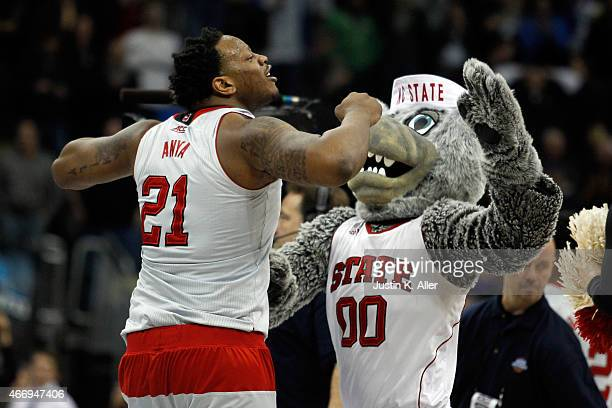 Beejay Anya of the North Carolina State Wolfpack celebrates after defeating the LSU Tigers 66 to 65 during the second round of the 2015 NCAA Men's...