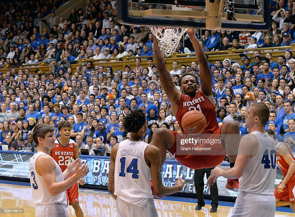 BeeJay Anya of the North Carolina State Wolfpack dunks over Brandon Ingram and Marshall Plumlee of the Duke Blue Devils during their game at Cameron...
