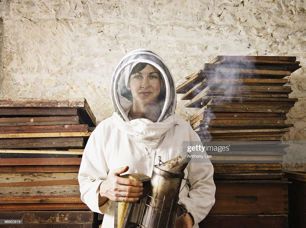 Beekeeper holding smoker