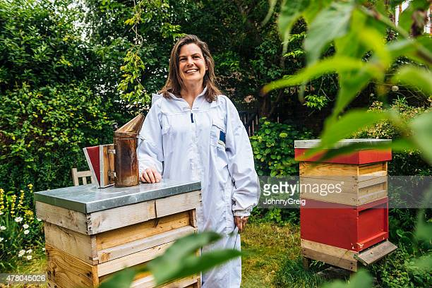 Beekeeper with her beehives