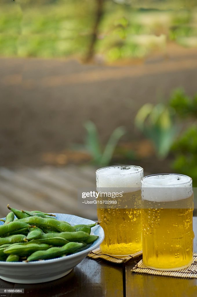 Beer and edamame : Stock Photo