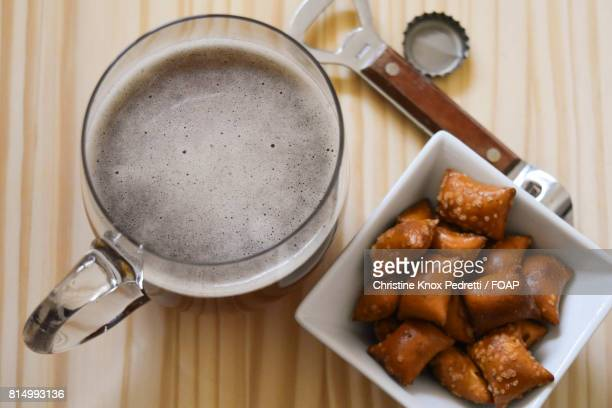 Beer and pretzels at on table