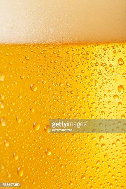 Beer Background   Ice Cold  Glass Covered with water drops  condensation