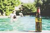 Beer Bottle At The Edge Of Pool