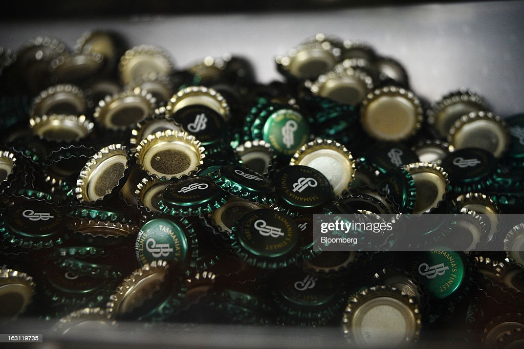 Beer bottle caps are loaded into a tray at the Boag's brewery, operated by Kirin Holdings Co.'s Lion unit, in Launceston, Tasmania, Australia, on Monday, Feb. 25, 2013. Australia's Bureau of Statistics is scheduled to release fourth-quarter gross domestic product figures on March 6. Photographer: Carla Gottgens/Bloomberg via Getty Images