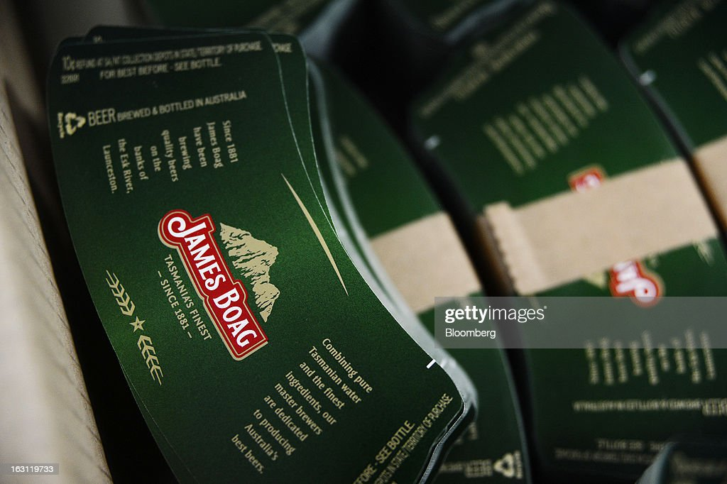 Beer bottle labels sit in a box before being loaded into a labeling machine at the Boag's brewery, operated by Kirin Holdings Co.'s Lion unit, in Launceston, Tasmania, Australia, on Monday, Feb. 25, 2013. Australia's Bureau of Statistics is scheduled to release fourth-quarter gross domestic product figures on March 6. Photographer: Carla Gottgens/Bloomberg via Getty Images