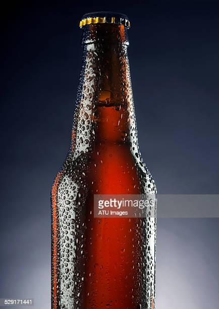 Beer bottle on blue