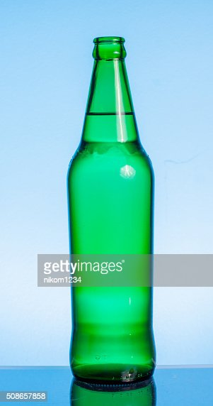 Beer bottle with drops isolated on wgite : Stock Photo