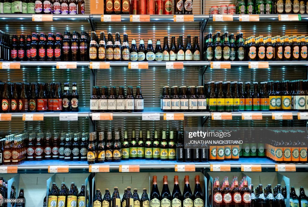 Beer bottles are displayed in one of the government controlled Systembolaget liquor stores in downtown Stockholm on December 19, 2013. Systembolaget is the only retail store allowed to sell alcoholic beverages that contain more than 3.5 percent (by volume) alcohol. According to Systembolaget, it has a nationwide retail network of 422 stores and over 500 agents serving smaller communities. AFP PHOTO/JONATHAN NACKSTRAND