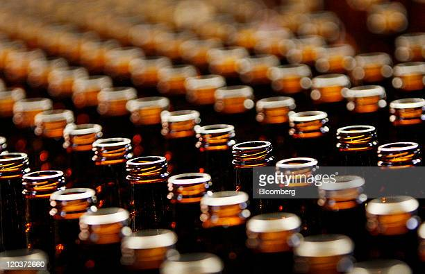 Beer bottles are seen here at the OwensIllinois Glass Plant in Waco Texas US on Thursday Aug 4 2011 OwensIllinois Inc the world's largest glass...
