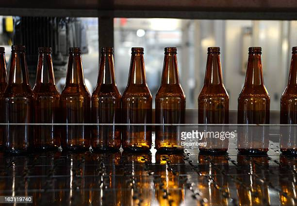 Beer bottles line a conveyor belt as they stand ready for bottling at the Boag's brewery operated by Kirin Holdings Co's Lion unit in Launceston...