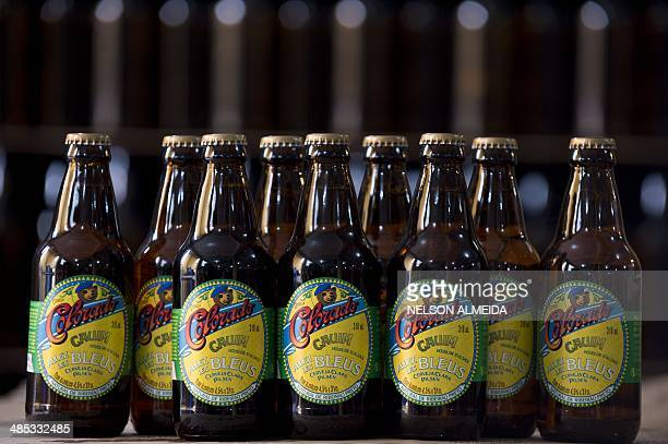 Beer bottles with labels reading 'Allez les Bleus' are seen at the artisanal brewery Colorado on April 16 2014 in Ribeirao Preto a city 336 km from...