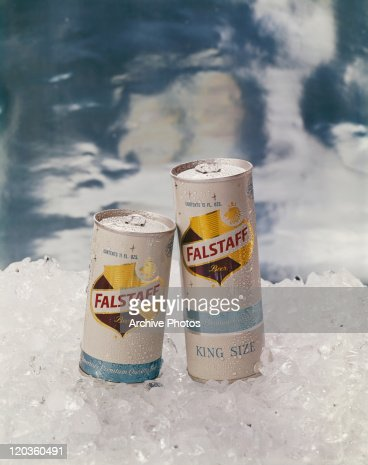 Beer cans on crushed ice, close-up