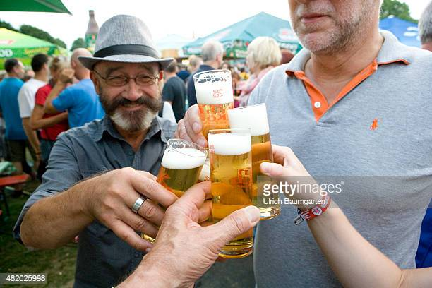 Beer festival in Bonn Toasting with filled beer glasses