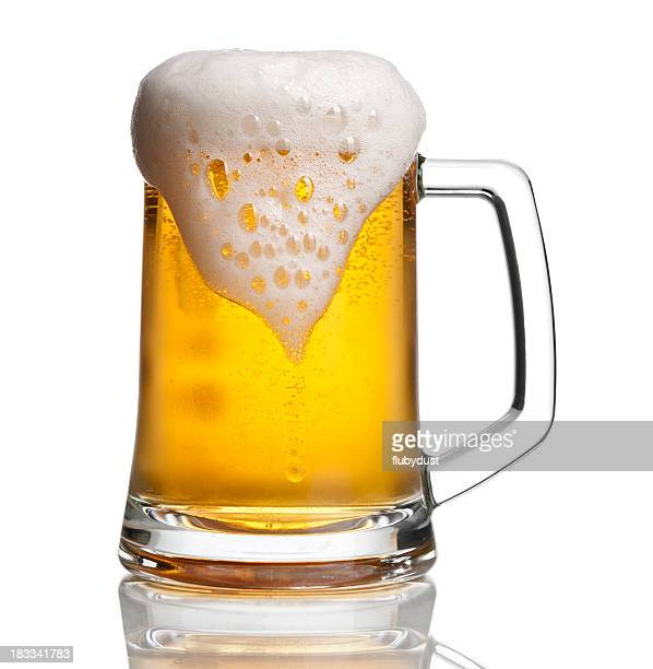 Beer glass with overflowing foam