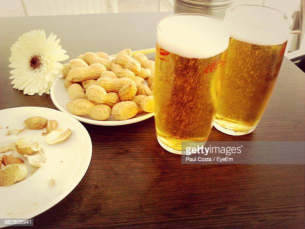 Beer Glasses With Peanuts On Table
