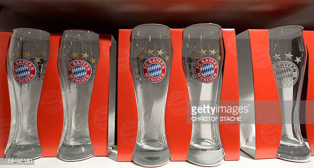 Beer glasses with the logo of German first division Bundesliga football club Bayern Munich are on display at the new Bayern Munich Fan Shop which...