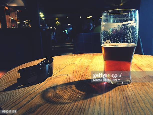 Beer In Glass By Sunglasses On Table