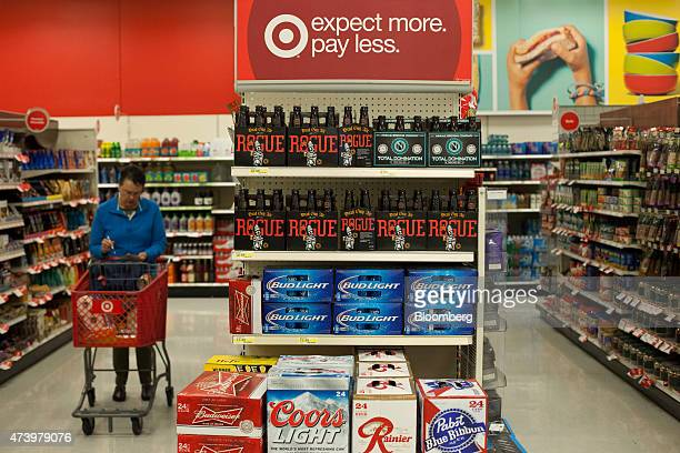 Beer is displayed for sale as a customer shops at a Target Corp store in Seattle Washington US on Thursday May 14 2015 Target Corp is scheduled to...