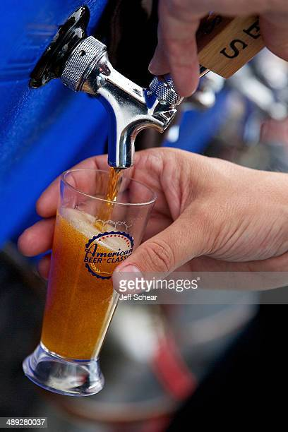 Beer is poured into a beer sampling glass at the American Beer Classic Chicago at Soldier Field on May 10 2014 in Chicago Illinois
