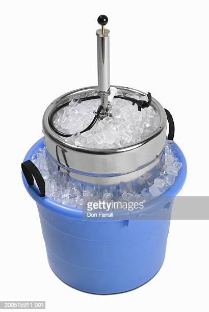 Beer keg in bucket of ice, elevated view