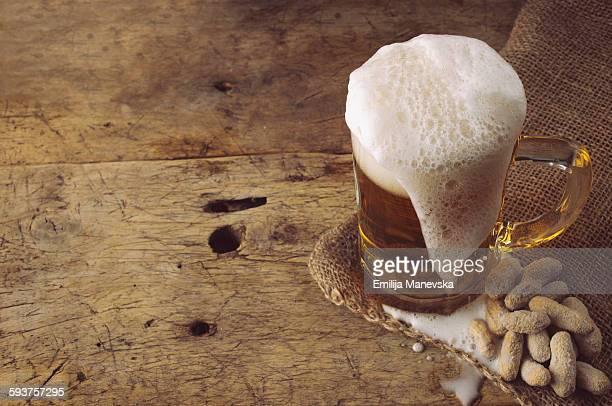 Beer mug and peanuts