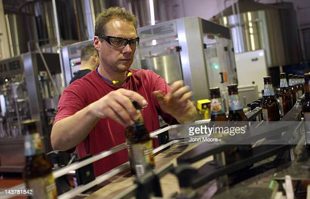 Beer packaging manager Randy Schull checks labels on the assembly line of the Captain Lawrence Brewing Company on May 3 2012 in Elmsford New York...