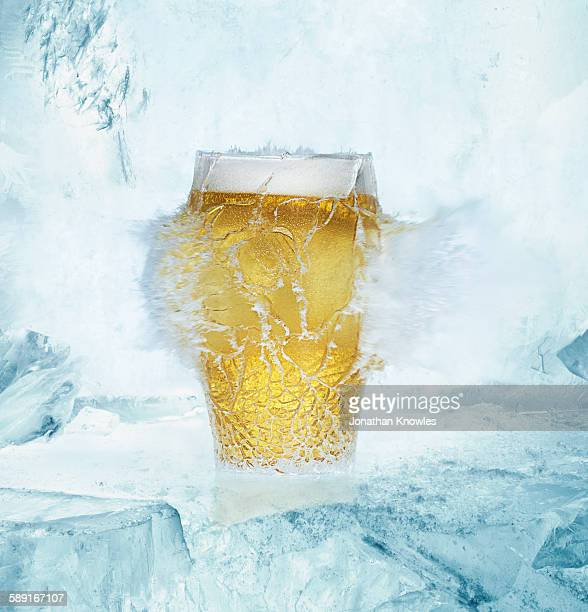 Beer pint glass exploding on ice