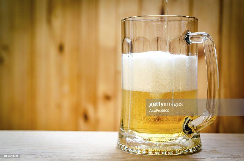 Beer pouring into mug : Stock Photo