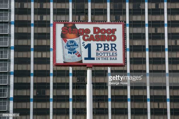 A beer promotion billboard above the Stage Door Casino liquor store on Flamingo Road is viewed on May 31 2017 in Las Vegas Nevada Tourism in...