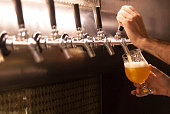 draught beer pouring into tulip glass