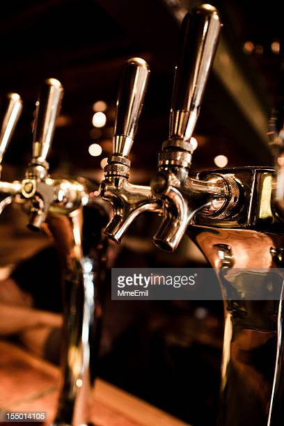 Beer taps in a bar on table top