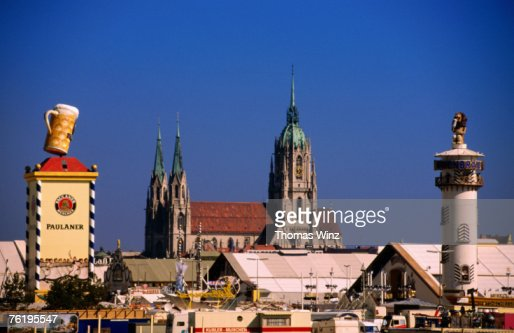 Beer Tents At Oktoberfest With Cathedral In The Background