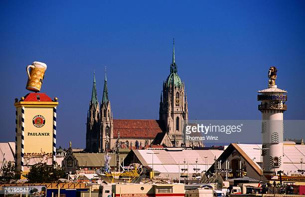 Beer tents at Oktoberfest with cathedral in the background, Munich, Bavaria, Germany, Europe