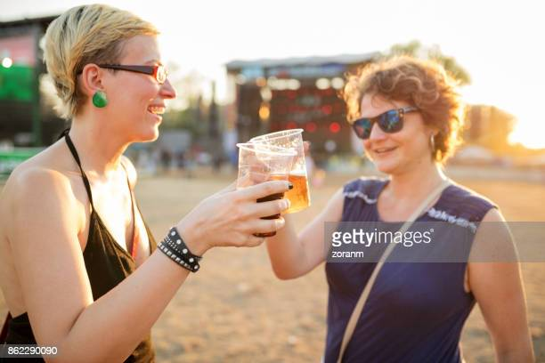 Beer toast at music festival