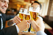 Businessmen drinking beer after successful deal
